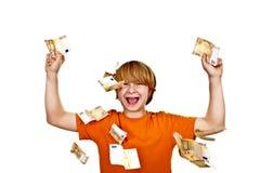 Euro, die um einen Jungenkopf fliegen Stockfotografie