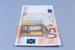 Euro- dinheiro em um fundo branco Fotografia de Stock Royalty Free