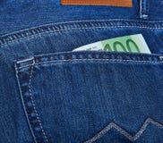Euro- dinheiro no bolso das calças de brim Fotografia de Stock