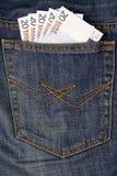 Euro- dinheiro no bolso das calças de brim Fotos de Stock
