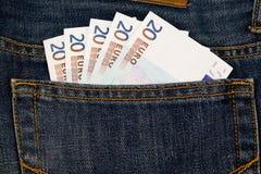 Euro- dinheiro no bolso das calças de brim Fotografia de Stock Royalty Free