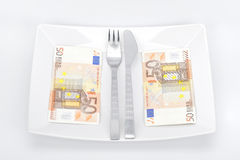 Euro dinner. Decoration with euro paper banknotes on plate Royalty Free Stock Photography