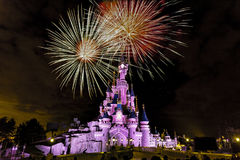 Euro Disneyland Paris castle. PARIS - 23 February 2016: Euro Disneylanf castle at the last fireworks show at night Royalty Free Stock Photos