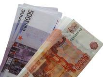 Euro do dinheiro com um pacote de 5000 rublos Imagens de Stock Royalty Free
