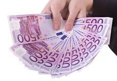 Euro do dinheiro na mão da menina. Imagem de Stock