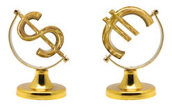 Euro and dollar. Signs on currency on a yellow support from under the globe, it is isolated on a white background stock photography