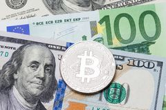 Euro and dollar background, silver bitcoin currency. Royalty Free Stock Photo