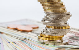 Euro and dollar banknotes and euro coins Stock Photography