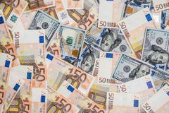 50 euro and 100 dollar banknotes Stock Images