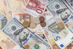 Euro and dollar bills with coins Royalty Free Stock Photography