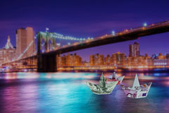 The euro and dollar boats against cityscape Stock Photography