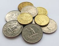 Euro and dollar cents on light background royalty free stock photo