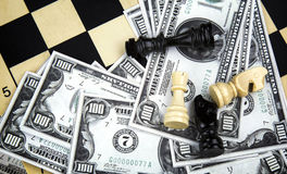 Euro And Dollar Money and Chess Royalty Free Stock Photography