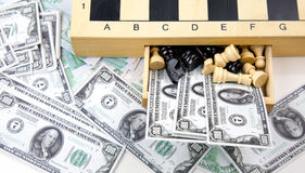 Euro And Dollar Money and Chess Stock Image