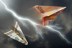 Euro and dollar plane. Business concept. euro and dollar plane and thunderstorm royalty free stock photography