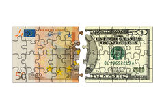 Euro and dollar puzzle Royalty Free Stock Photo