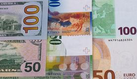 100 and 50 euro dollar, swiss franc background. 100 and 50 euro dollar, swiss franc background Royalty Free Stock Photos