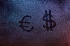 Euro and dollar symbol. On frozen fog window. Currency signs on fogged glass royalty free stock image