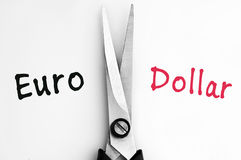 Euro and Dollar words with scissors in middle Stock Image