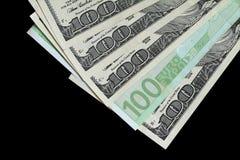 A Euro Among Dollars. A Euro banknote inserted among US hundred dollar bills Royalty Free Stock Photography