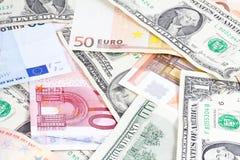 Euro and dollars bills Stock Image