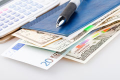 Euro and dollars in notebook Royalty Free Stock Photo