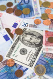 Euro e contas e moedas de dólar Imagens de Stock Royalty Free