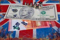 Euro e dólar americano na bandeira britânica Imagens de Stock