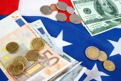 Euro e dólares Imagens de Stock