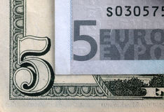 5 euro e 5 dólares Imagens de Stock Royalty Free