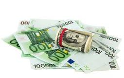 Euro e dólares no fundo branco Imagens de Stock Royalty Free