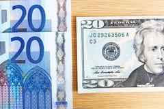 Euro e dollari Immagini Stock