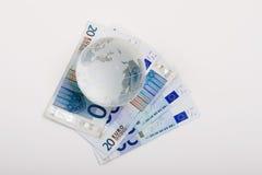 Euro e globo imagens de stock