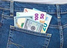 Euro e moeda americana, dinheiro no bolso para o curso Imagens de Stock Royalty Free