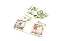 Euro e pacchetto bruciati dei dollari Fotografia Stock
