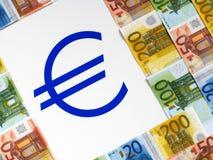 EURO e segno dei soldi fotografie stock
