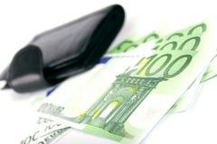 Euro e uma bolsa de couro fotografia de stock royalty free