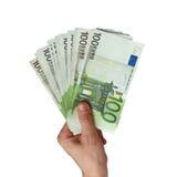 Euro in een hand van de man Stock Foto's