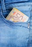 Euro 50 em um bolso das calças de brim Imagem de Stock