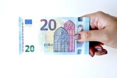 Euro 20 en main Photos stock