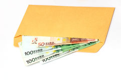 EURO in the envelope. Some EURO in the gold envelope, isolated Royalty Free Stock Image