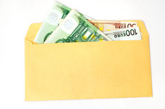 EURO in the envelope. Some EURO in the gold envelope, isolated Stock Image