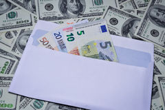 Euro in an envelope. On the background of dollars stock photo