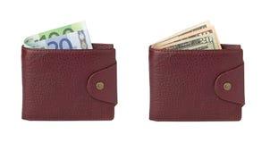 Euro et dollars dans des portefeuilles Photographie stock libre de droits