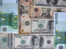 Euro et dollars de billets de banque comme fond Image stock