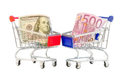 Euro et dollars de caddie Photographie stock