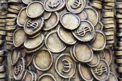 Euro et dollars de pièces de monnaie Photos libres de droits