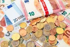 Euro (EUR) banknotes and coins Royalty Free Stock Photos