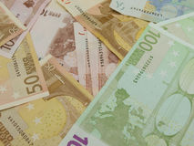Euro notes and coins Stock Photography