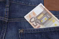 Euro (EUR) in a pocket. 50 Euro (EUR) note in the  pocket of a pair of blue jeans Royalty Free Stock Images